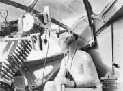 At Sea Interior of a RAAF Catalina air gunner at his station low level anti-submarine Patrol from Cairns