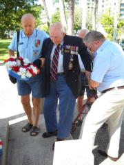 Bill Jackson and fellow members helping him with Wreath Placing.
